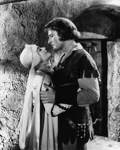 Olivia de Havilland and Errol Flynn as Robin Hood