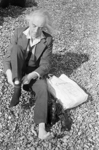 Quentin Crisp, on location, acting in British Film Institute (BFI) sponsored Film, VALUE FOR MONEY, on location. Aldeburgh, Suffolk, England 1970. Photograph by Richard Keith Wolff