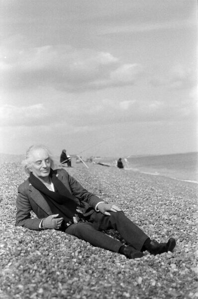 Quentin Crisp, relaxing between scenes, he is acting in the BFI Film, VALUE FOR MONEY, on location. Aldeburgh, England 1970