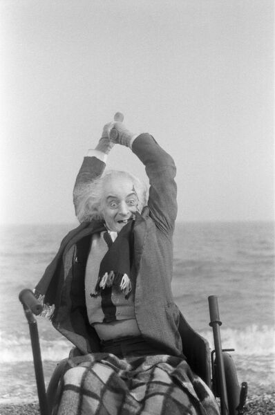 Quentin Crisp, on location for a British Film Institute Production Board film: VALUE FOR MONEY. Quentin Crisp in make up and costume for the part he is playing; this is a time just before he became well-known for his eccentric autobiography