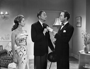 Anne Vernon, Mischa Auer and Dennis Price in John Guillermin's Song of Paris (1952)