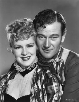 Claire Trevor and John Wayne in John Ford's Stagecoach (1939)
